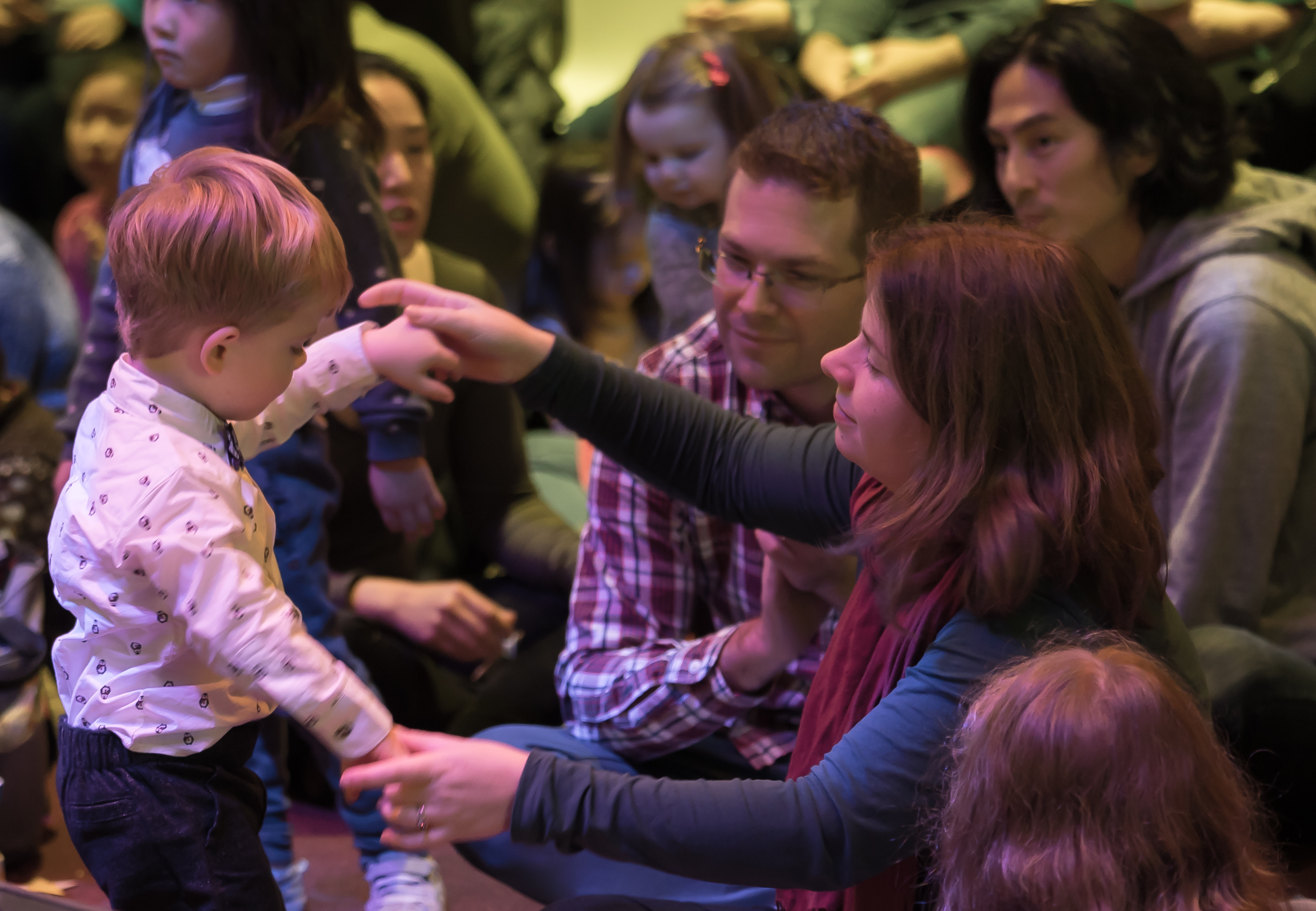 A toddler dances with his mother at a free LC Kids concert in the Atrium.